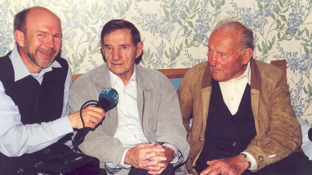 Ernst Vogt von Rucksackradio mit Anderl Heckmair und Ricardo Cassin